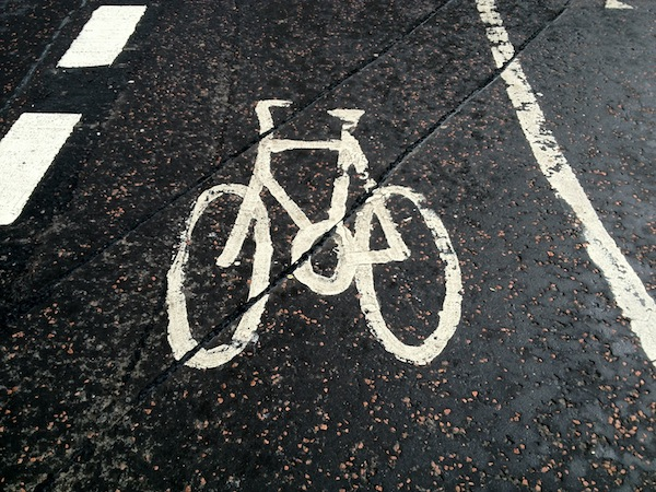 cycling logo on road