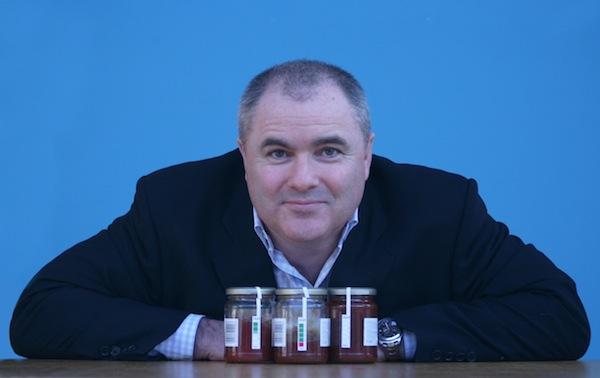 UWI Pete Leaning over jars