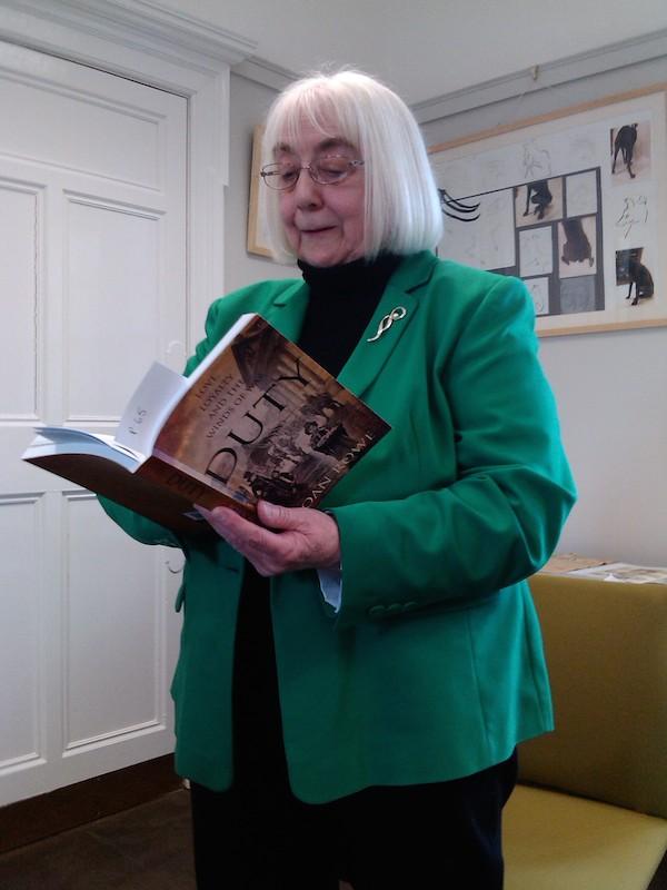 Joan reading from Duty