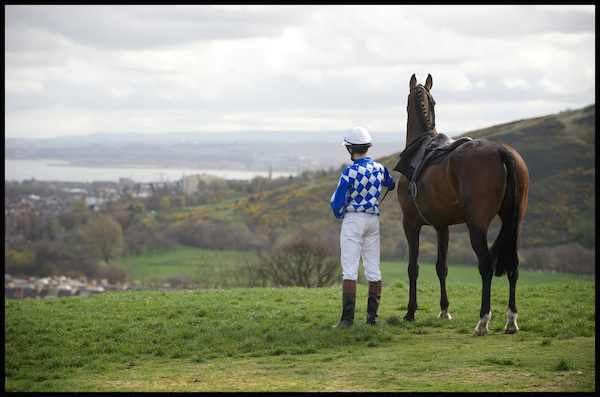 Jockey Robert Hogarth and Soul Magic look out onto the home of the Edinburgh Cup, Musselburgh Racecourse, from a distance