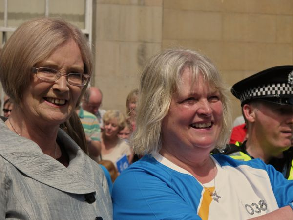Lynne McNicoll baton bearer with Presiding Officer Tricia Marwick MSP