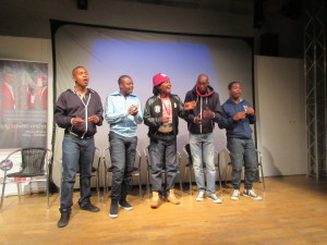 Group singing at film preview