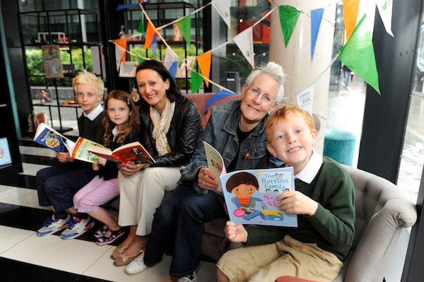 Pic Greg Macvean - 21/08/2014 - 07971 826 457 Children's author Vivian French visits Looking Glass Books at The Quartermile to celebrate the launch of Scottish Power Foundation's Library Energiser Launch left to right - Henry Hayward (8), Jessica Hayward (5), Ann Loughrey - Executive Officer and Trustee Scottish Power Foundation, Vivian French, George Cowie (6)