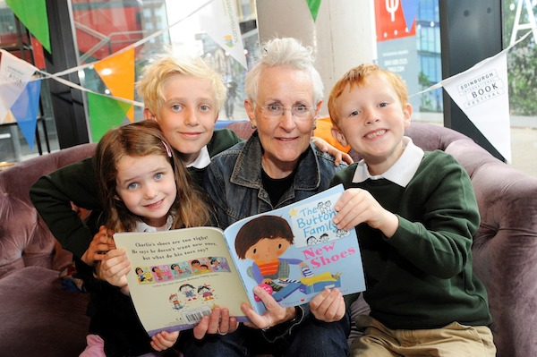 Pic Greg Macvean - 21/08/2014 - 07971 826 457 Children's author Vivian French visits Looking Glass Books at The Quartermile to celebrate the launch of Scottish Power Foundation's Library Energiser Launch kids left to right - Jessica Hayward (5),  Henry Hayward (8), George Cowie (6)