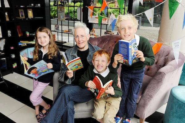 Pic Greg Macvean - 21/08/2014 - 07971 826 457 Children's author Vivian French visits Looking Glass Books at The Quartermile to celebrate the launch of Scottish Power Foundation's Library Energiser Launch kids left to right - Jessica Hayward (5),  George Cowie (6), Henry Hayward (8)