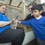 Janitor Mrs Smith (left) and Amir Nasrani with Max the Rabbit