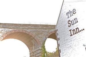 The Sun Inn below the bridge
