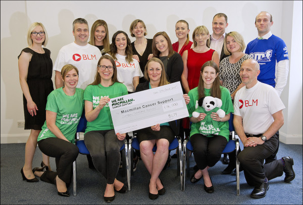 Some of the BLM EMF running team presenting their £16,000 donation to Macmillan Cancer Support