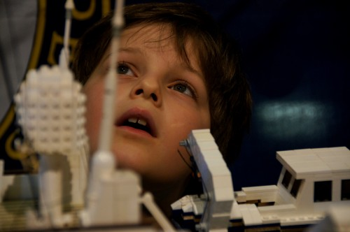 Henry Hussain (8) admires the detail of the replica yacht