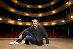 """FREE PICTURE: David Greig starts as new artistic director at The Royal Lyceum Theatre, Edinburgh, Tuesday 03/05/2016: Royal Lyceum Theatre Edinburgh new artistic director David Greig announces first theatrical season, Edinburgh, Tuesday 03/05/2016: New artistic director of the Royal Lyceum Theatre Edinburgh, pictured with the set of """"Iliad"""" - David's first production. Free FIRST USE (ONLY) picture. More info from: Clare McCormack, Senior Publicist at The Corner Shop PR: email: press@lyceum.org.uk /07989 950871 or Harriet Mould, The Lyceum Press and PR Officer: email: hmould@lyceum.org.uk / 0131 202 6220 / 07454 816 116 Photography from: Colin Hattersley Photography - colinhattersley@btinternet.com - www.colinhattersley.com - 07974 957 388"""