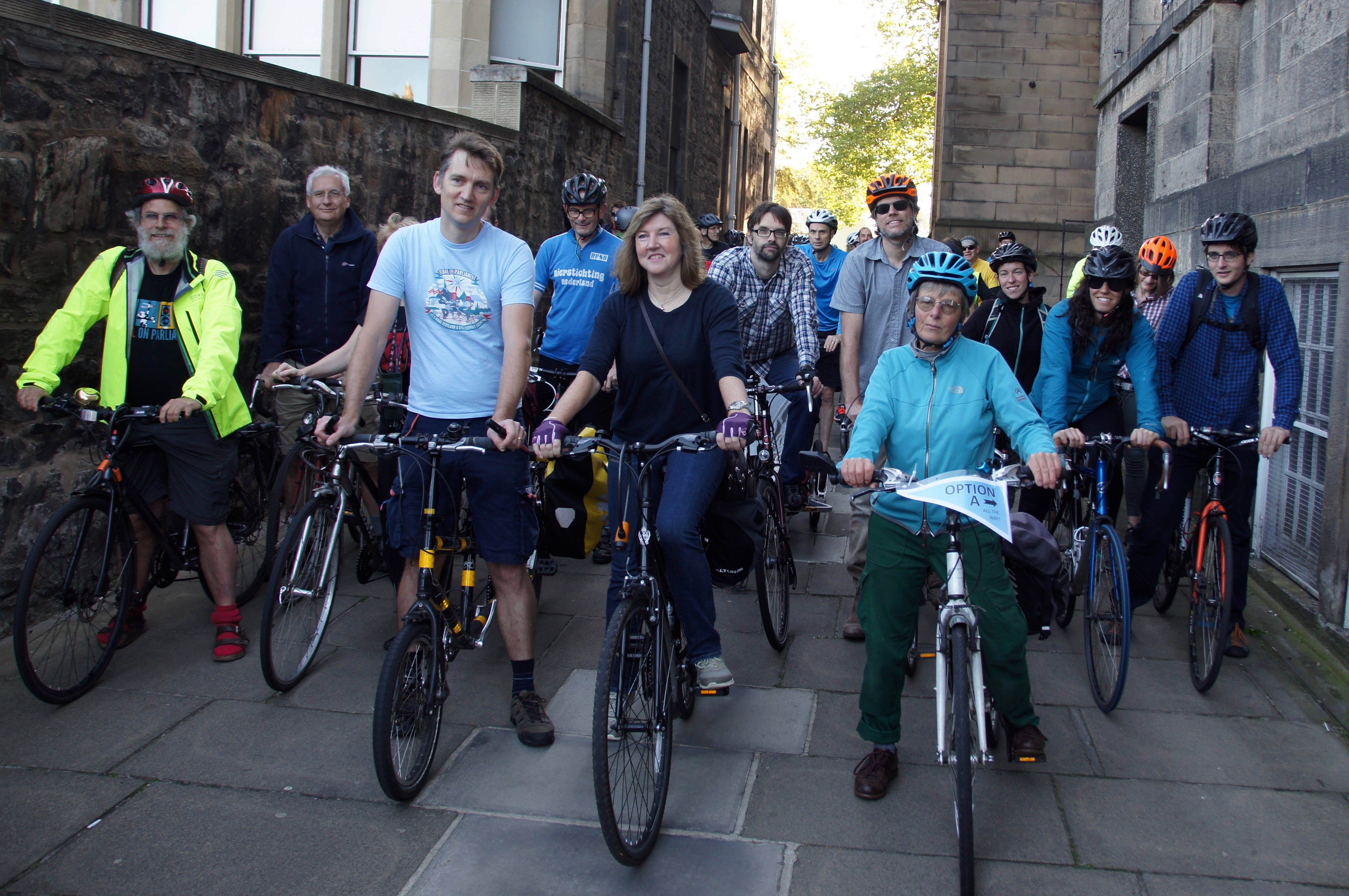 pro-cycling campaigners lined up on cycle route on bikes
