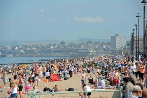 Portobello beach again packed with sun worshipers as the temperatures sore.