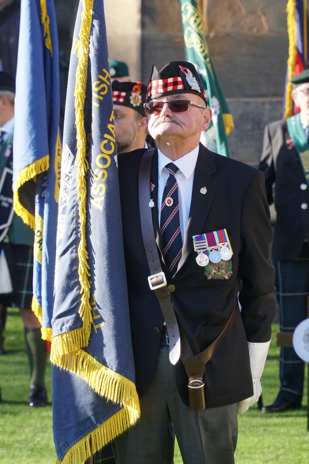 A standard bearer at the Garden of Remembrance opening ceremony 2018