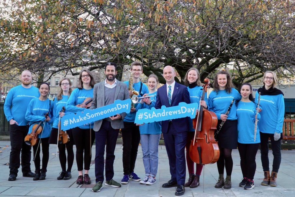 Minister Ben Macpherson with musicians at St Andrew Square