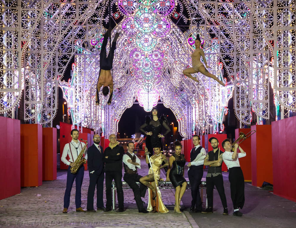 Circus performers with lights above