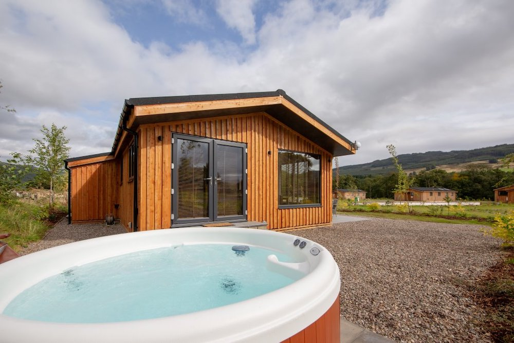 A hot tub outside one of the lodges