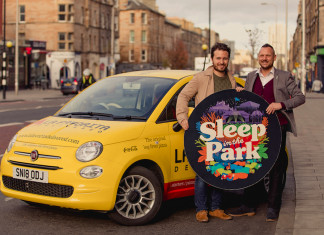 Josh Littlejohn and Chris Logan with a Vittoria delivery car and the Sleep in the Park logo