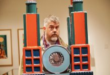 Phill Jupitus behind the Four Towers by Paolozzi