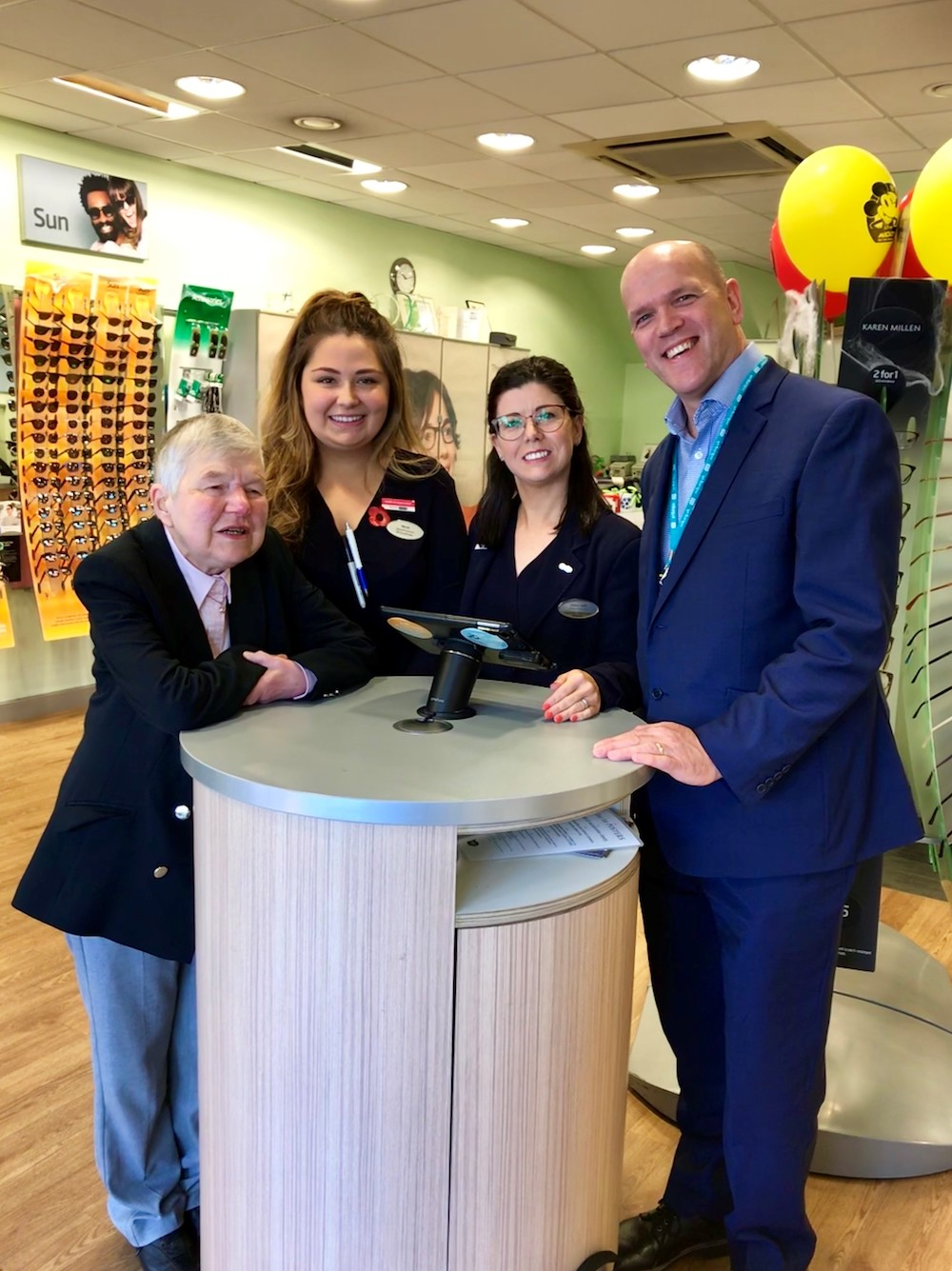 Specsavers staff and RNIB representatives pose in the Musselburgh store
