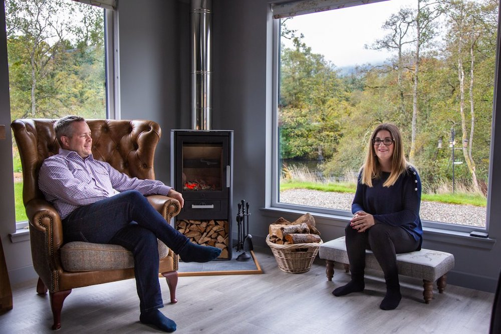 Alex and Daniela relaxing  in front of the log fire