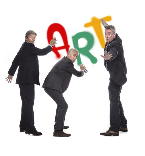 Three actors pose with the word ART