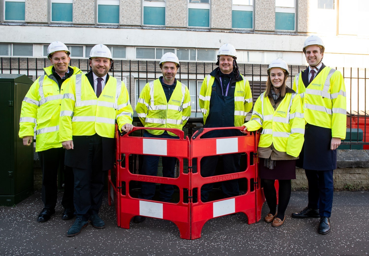 Politicians with a number of Openreach engineers