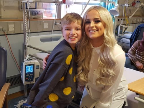Caitlyn Vanbeck with patient Lily Douglas aged 11 in hospital