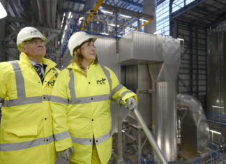 Two Councillors in hard hats and high visibility jackets visit the new FCC Environmental Plant in Millerhill, Edinburgh