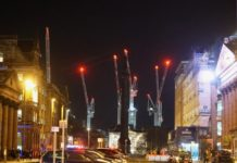 Cranes in the night sky above Edinburgh St James