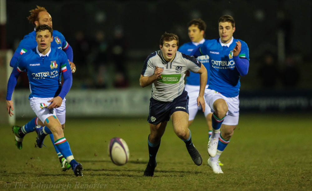 Scotland player chasing the ball