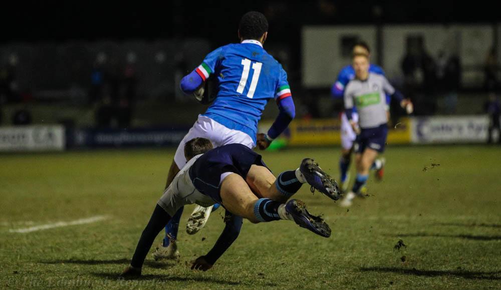 Italian player dodges Scotland player