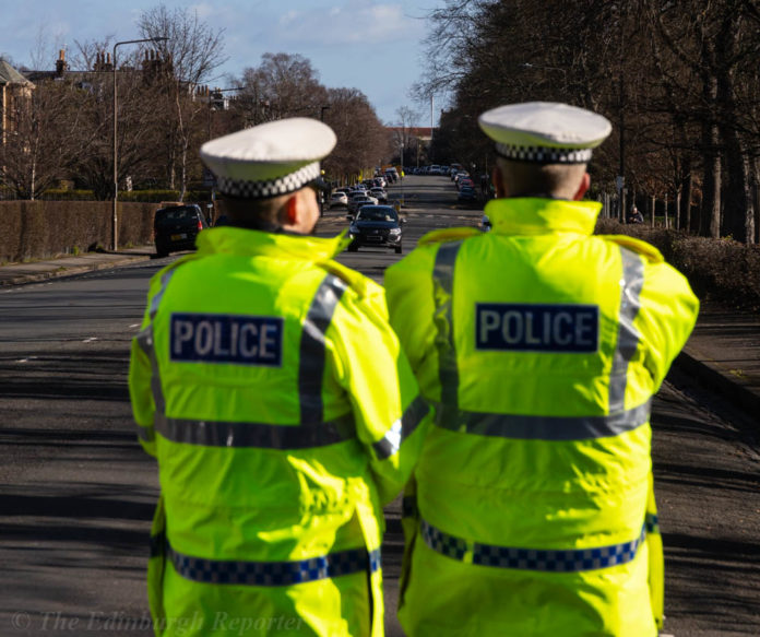 Police checking car speeds