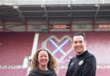 Edinburgh Napier's Dr Susan Brown with Kevin Murphy, Heart of Midlothian Girls Academy and Women's Manager at Tynecastle Park.