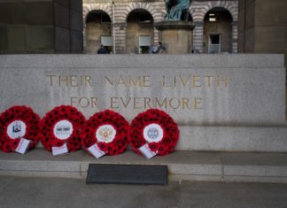 Line of four wreaths of poppies at the National War Memorial