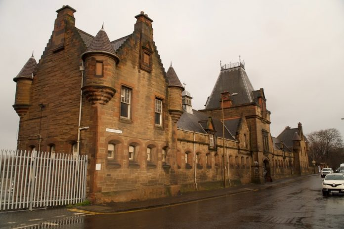 Facade of Powderhall Stables with complex slate roof