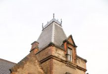 Central part of red sandstone facade at Powderhall Stables