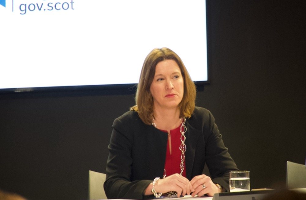 Dr Catherine Calderwood the Chief Medical Officer at a media briefing sitting behind a desk
